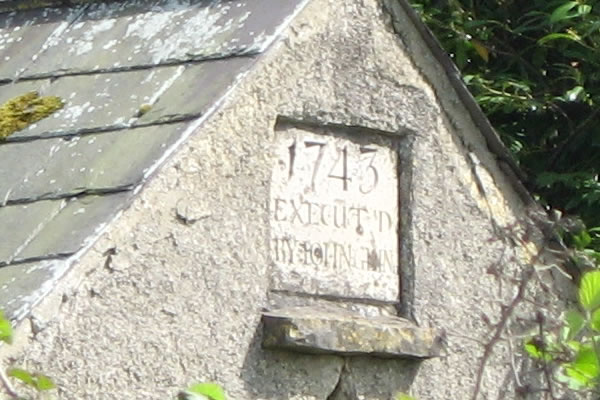 There is a date-stone inscribed 1743 and EXECUT'D BY JOHN GLIN.