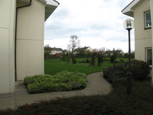 Landscaped path between the buildings at Watch Tower House, Ireland's Bethel