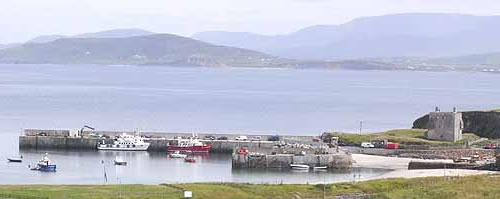 Clarre Island Harbour with Granuaile's Castle seen to the right Carrowmore Hill is on the mainland on the opposite shore with the mountains of Mayo beyond. Photo by Oliver Dixon - Islands of Ireland's Western Connemara – Ireland, A Different Visit