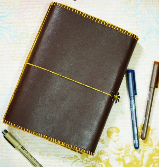 Handmade leatherette cover and 3 hand stitched notebooks
