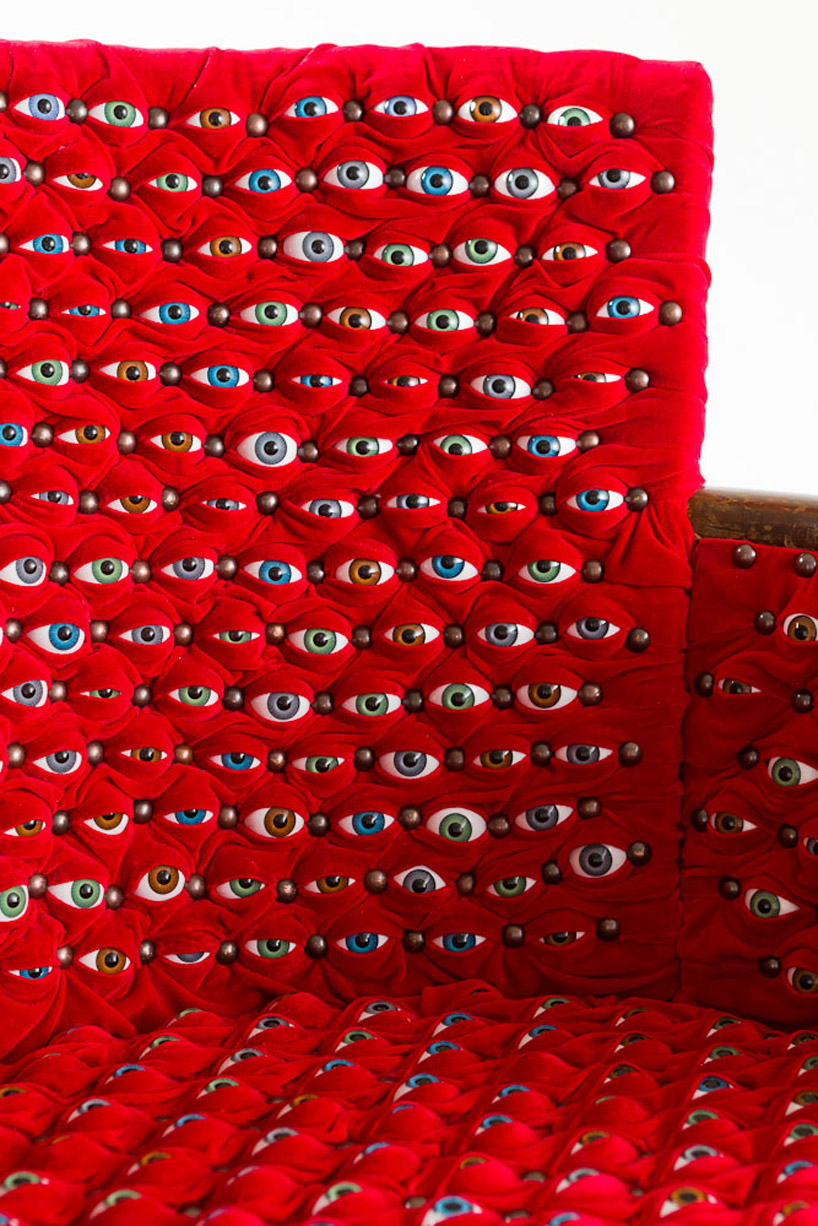hundreds of eyes make up the scopophilia chair by fiona