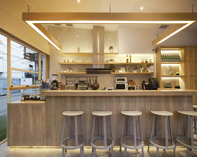Party Space Design Creates A Simple Common Room Cafe In