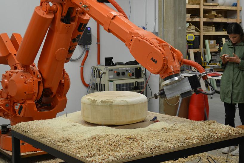sasha ritter  armand graham sculpt totoro wooden stools with a robot