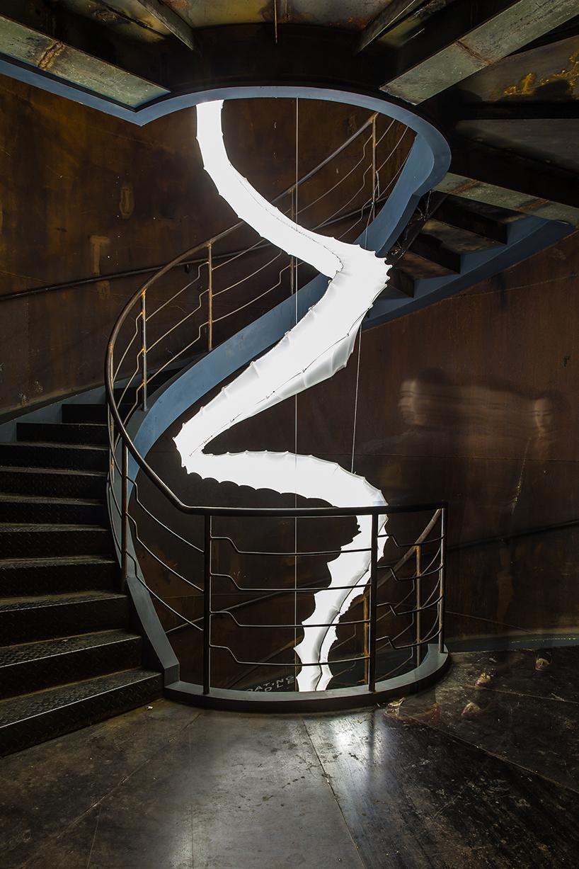 update studio spirals smoke installation along a staircase