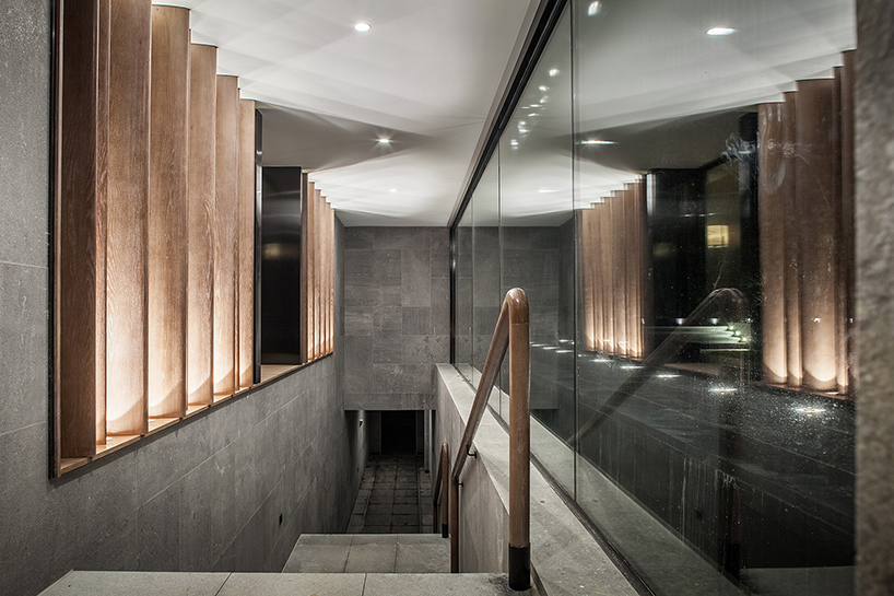 CL3s tea house in china uses wood bamboo and marble to reflect on the zen aesthetic