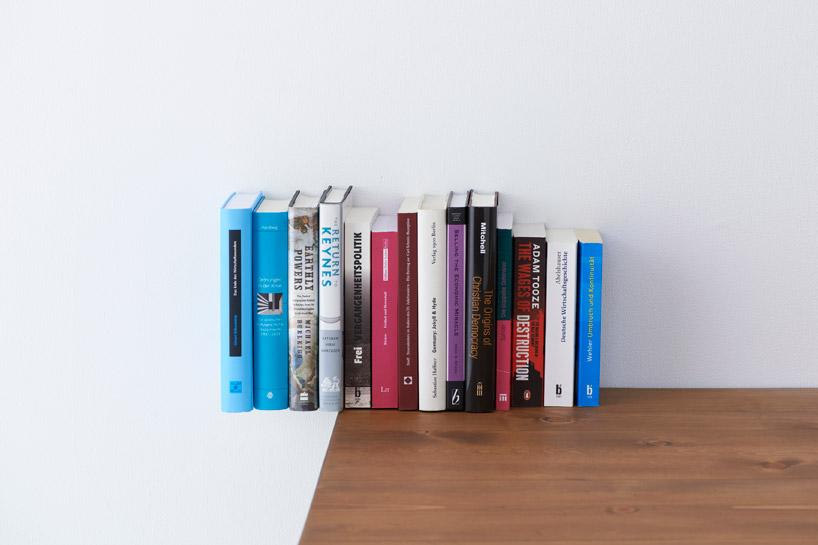 the revolving chair miami office for sciatica yoy design studio: book planter + shelf extenders