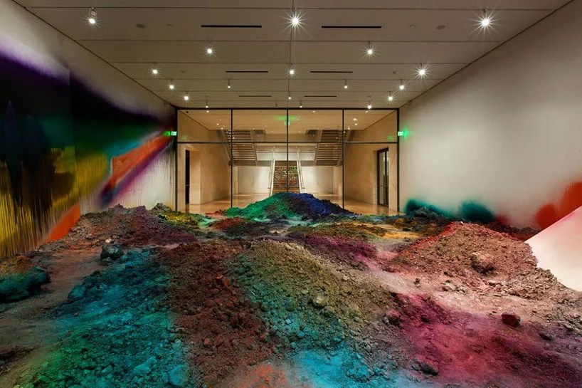 colorful mountains of spraypainted soil by katharina grosse