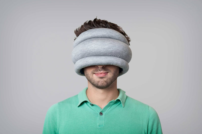ostrich pillow light is a portable pillow for public napping