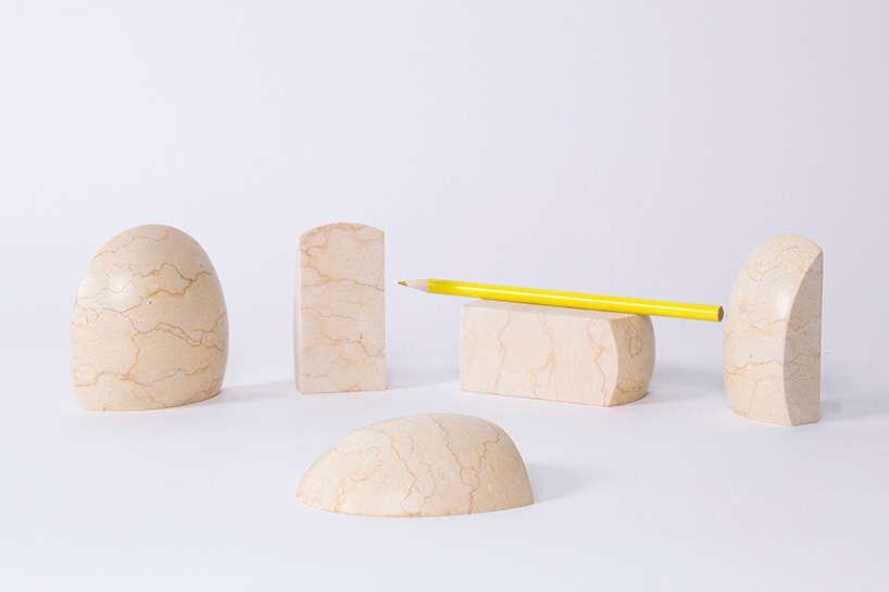 jinsik kim sculpts stone age collection from colored marble