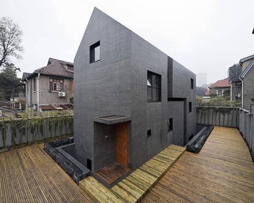 AZL architects carves a concrete block into the slit house