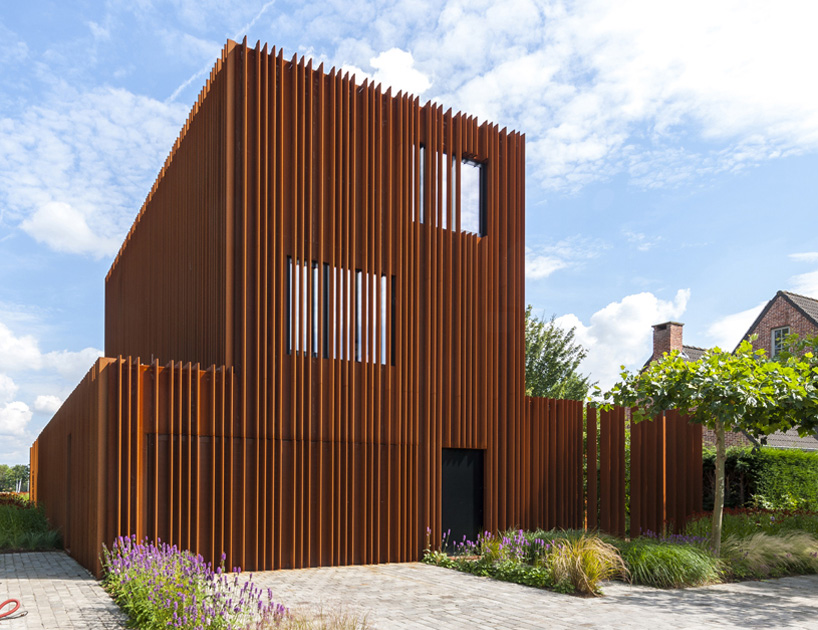 DMOA architecten forges corten house from weathering steel