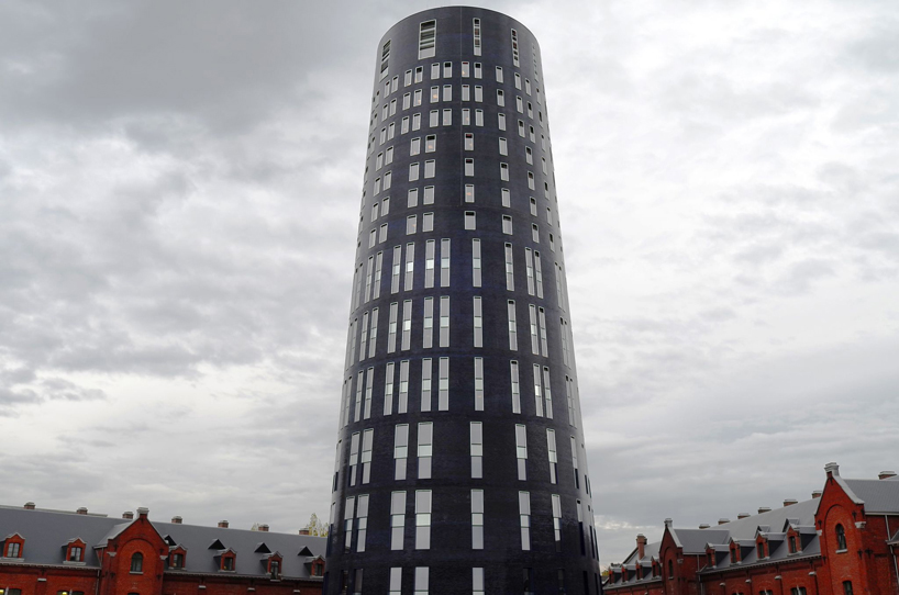 jean nouvel extends charleroi police headquarters with 75 meter tower