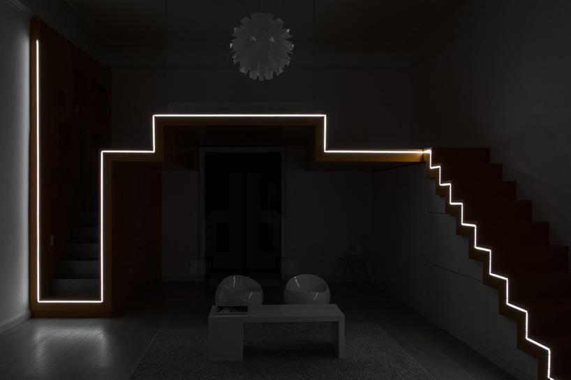 batlab shapes hungarian bedroom loft with zigzagging light