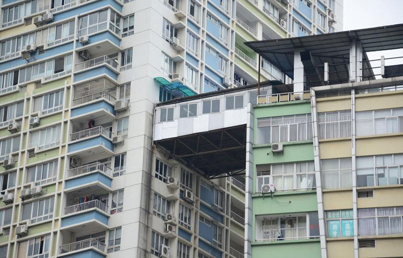 illegal corridor precariously bridges two highrise