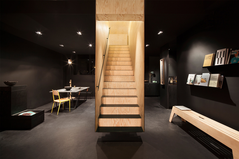 a floating staircase defines interior of bazar noir by