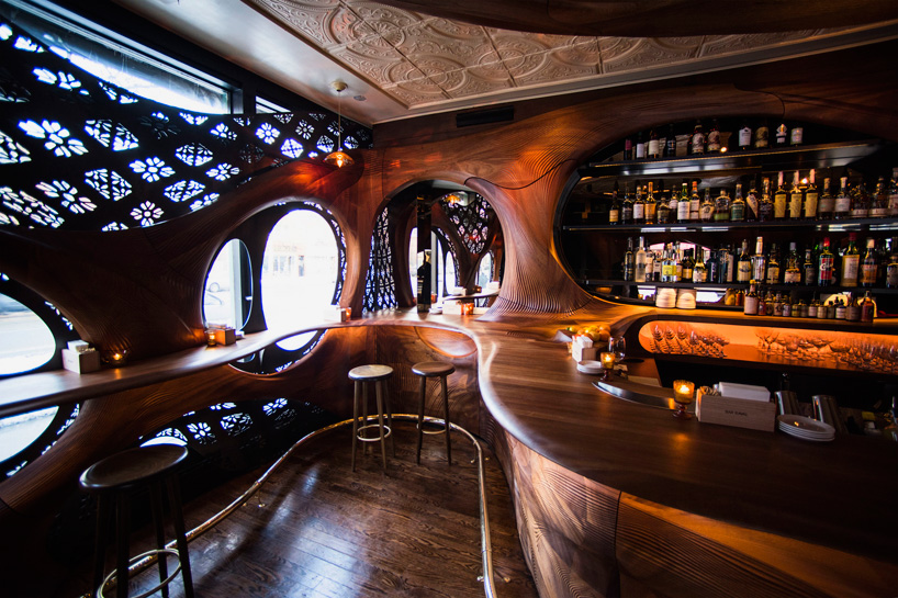 Bar Raval By Partisans Features Carved Mahogany Interiors