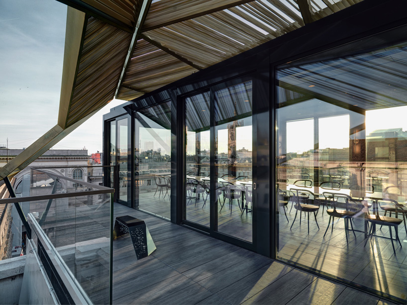 park associati installs popup restaurant on a milan rooftop