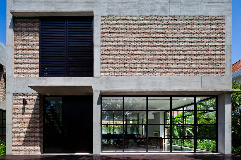 MM architects wraps vietnamese villa with pivoting doors