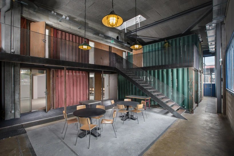 shipping container music venue by savioz fabrizzi architectes