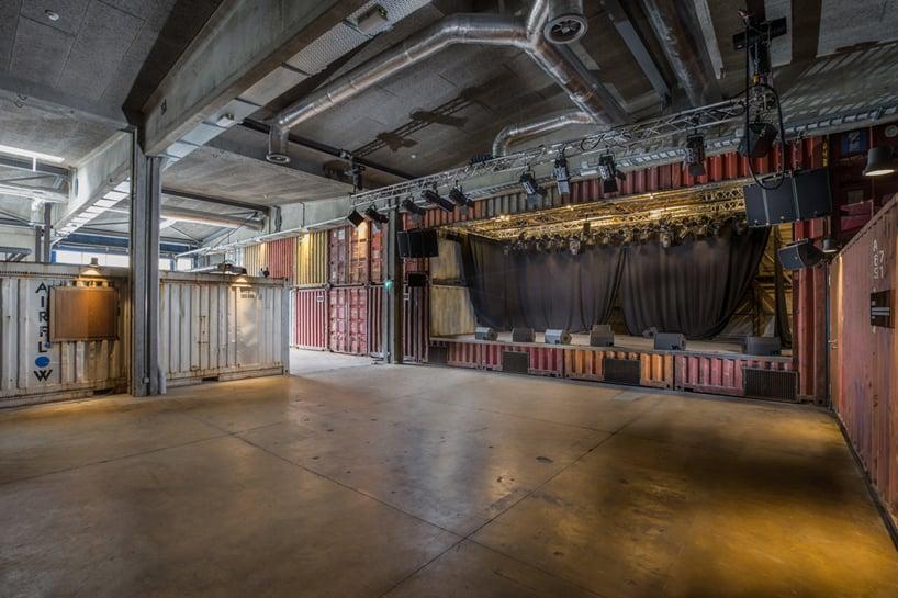 shipping container music venue by savioz fabrizzi architectes