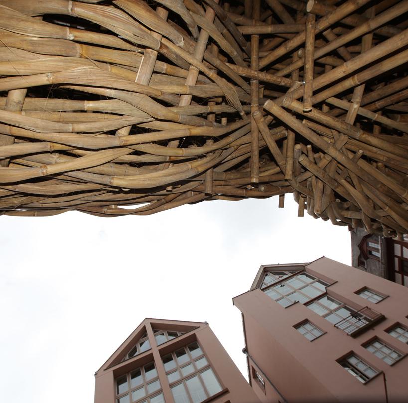 joko avianto wraps bamboo weaving across frankfurter kunstverein faade