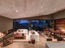 elias rizo arquitectos clads casa gg with polished steel