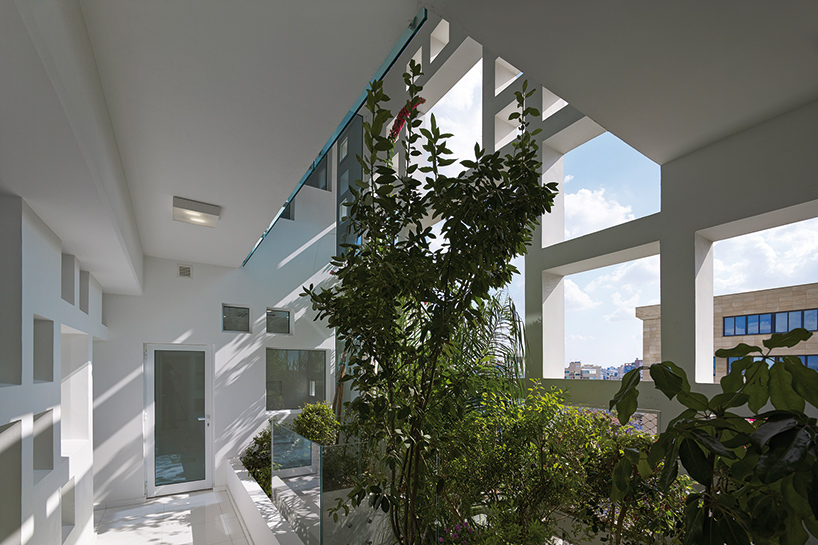 greenery emerges through jean nouvels pixelated white walls tower in cyprus