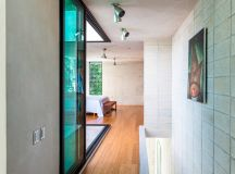 taller estilo installs double height glass doors to ...