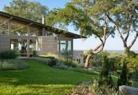 lake flato's hillside house in texas overlooks downtown austin