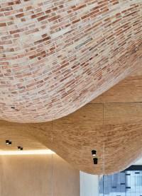 fucina restaurant in london features a bulbous brick ceiling