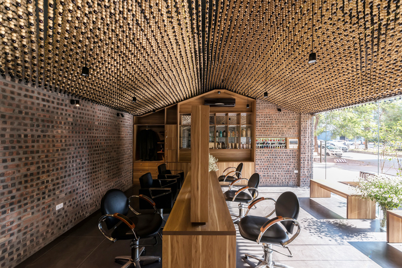 HP architects install a ceiling of beads inside vietnamese hair salon