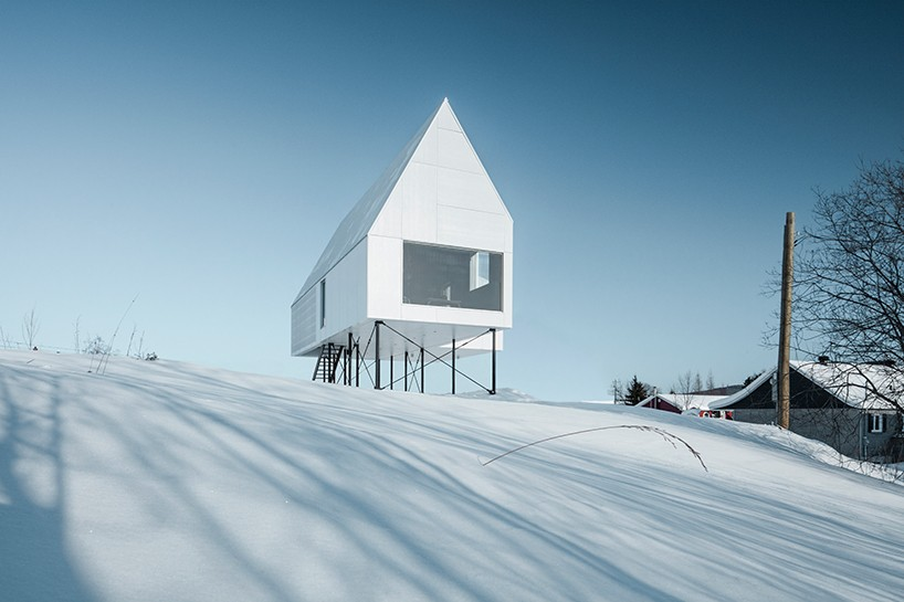 delordinaire elevates high house above snowcovered landscape in quebec