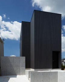 Takatina Completes Elevated Black Box House In Suburban Japan