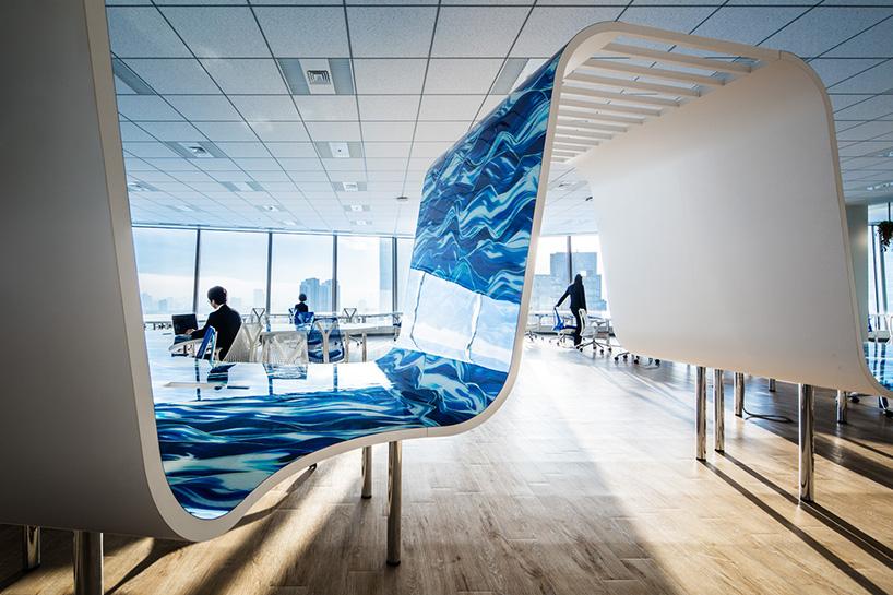 teamlabs digital office for DMM in tokyo features a 1kilometerlong desk