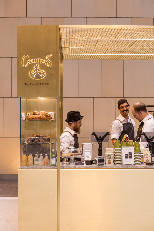woods bagot positions brass coffee kiosk inside sydney tower