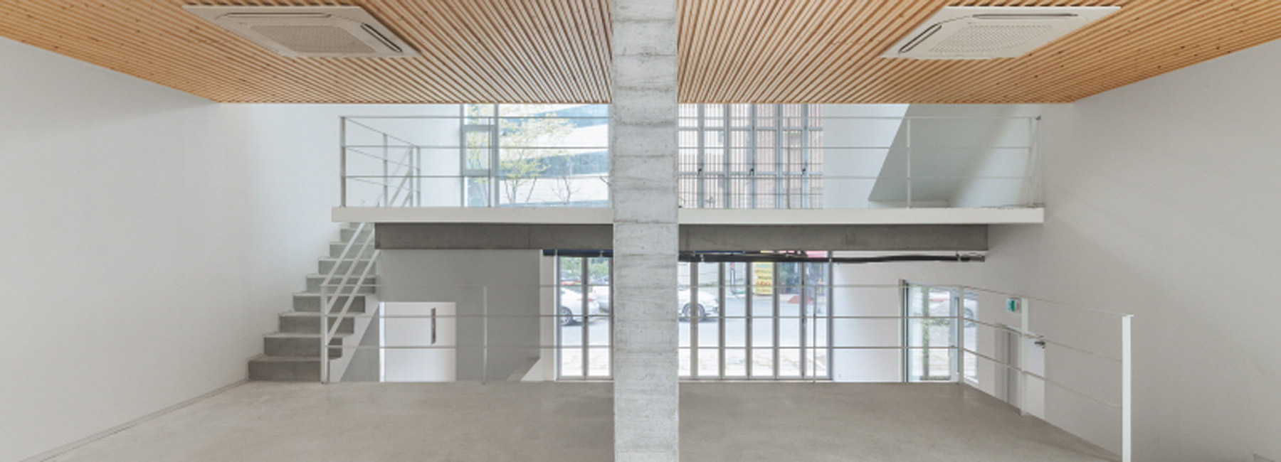 2m2 architects designs korean caf with a skip floor layout and contrasting materials