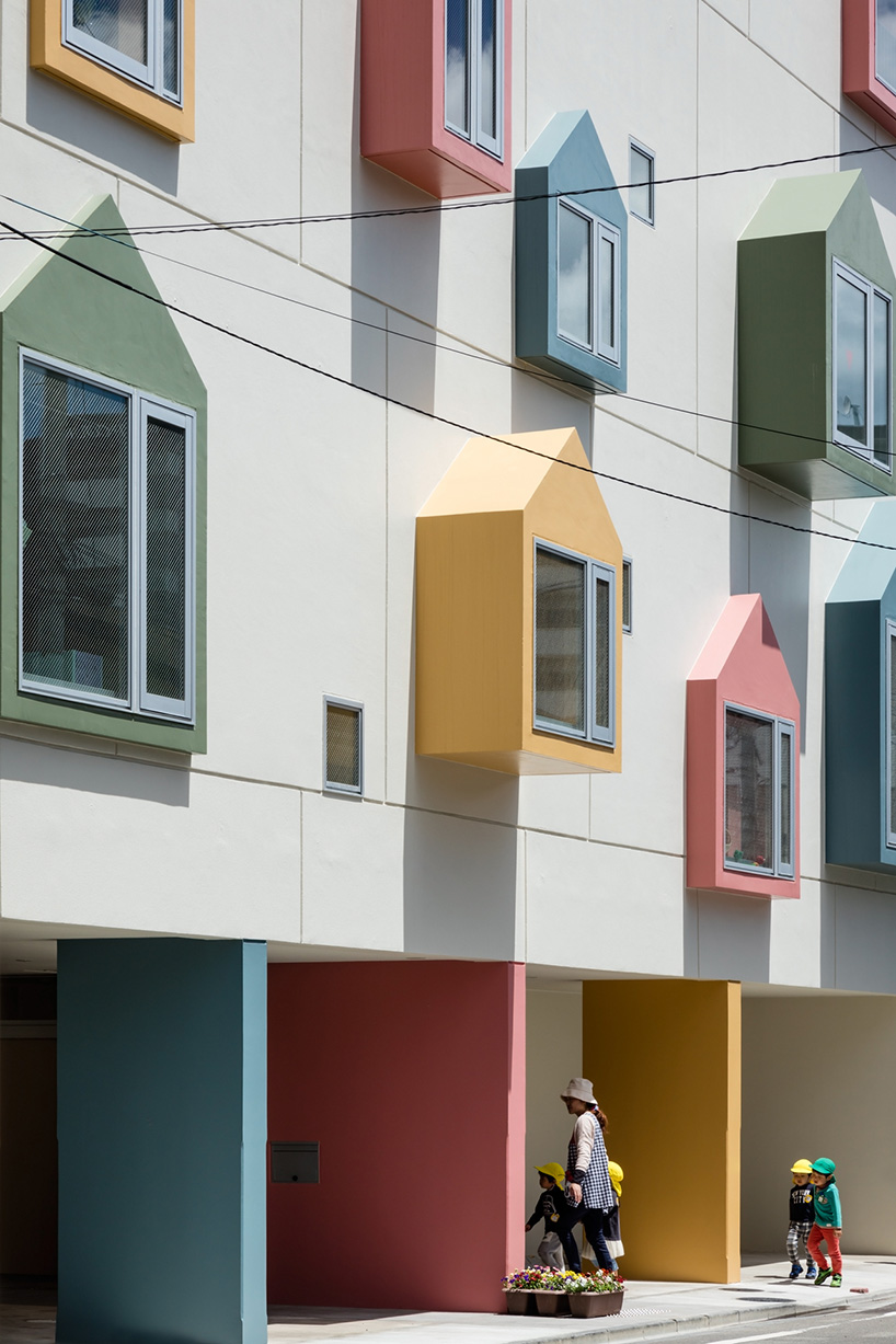 nursery school welcomes students into learning space with colorful facade