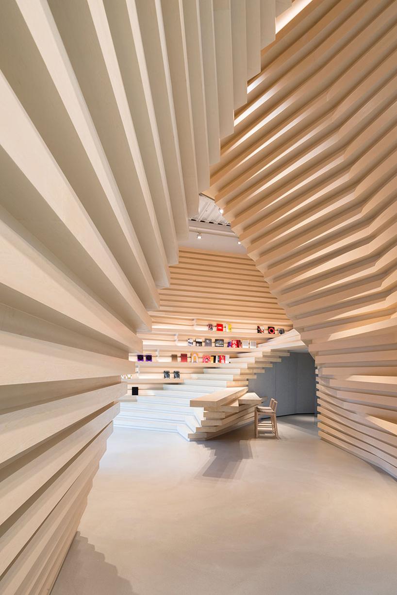 kengo kuma creates stacked wooden facade for whitestone gallery in taipei