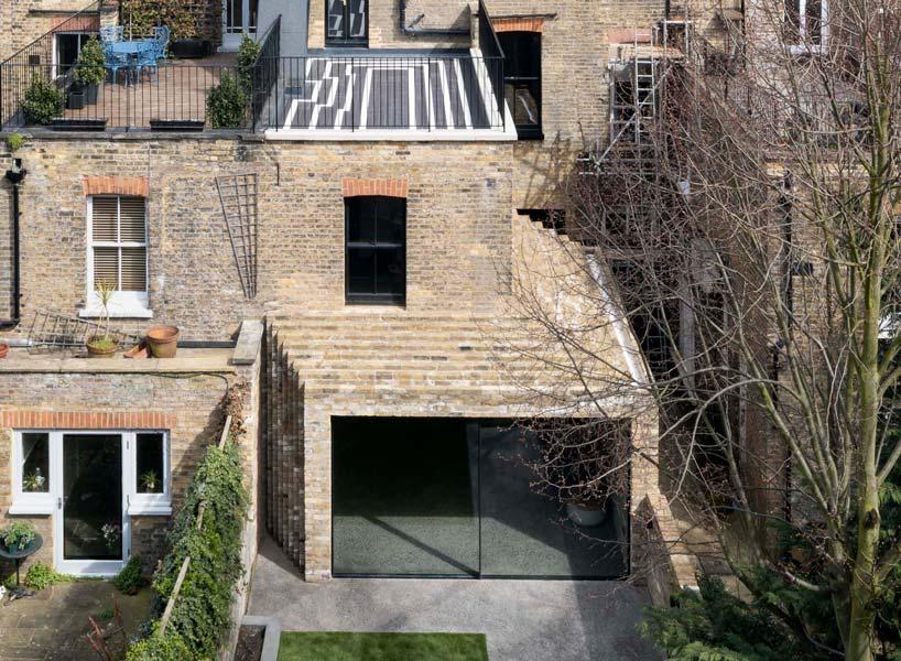 bureau de change elevates the humble brick in this north london step house