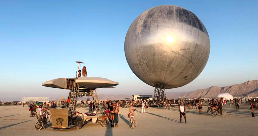 wooden library chair revolving features bjarke ingels + jakob lange bring giant reflective 'orb' to burning man