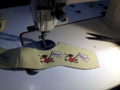 """NC Birds"" shoe being sewn"