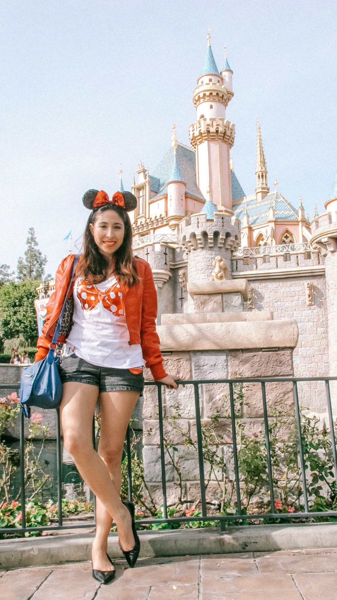 Woman in front of Disneyland Castle