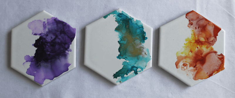 DIY alcohol ink coasters on tile. A fun and easy project. Make these for a gift as art as coasters, or just for fun. #alcoholinkcoasters. tile coaster set
