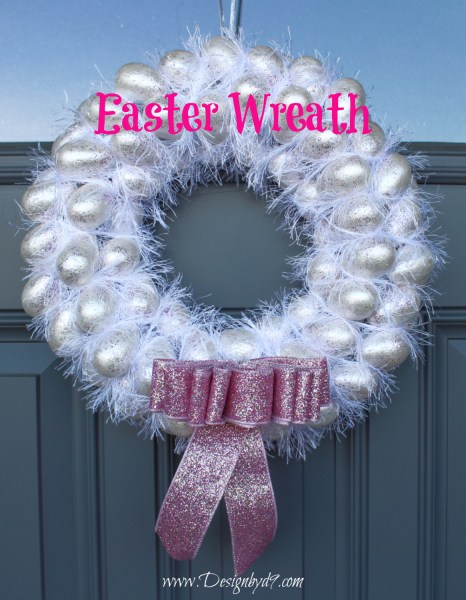 Feathered Easter Egg wreath. This is an Easy DIY Easter project to make for your front door. How to make a fluffy easter egg wreath with eggs and paint. Add a touch of feathers to this homemade wreath with yarn. Most of the supplies are from the dollar store to keep this project cheap. #Designbyd9 #Easterwreath