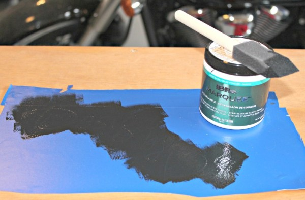 Staining and detailing the workbench. Use your Cricut cutting machine to personalize your garage.