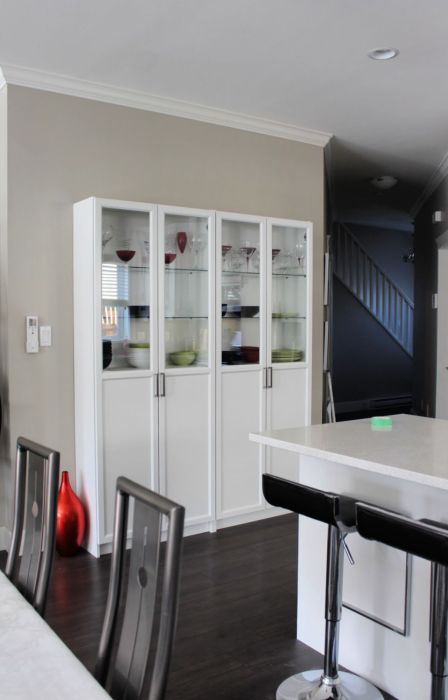 Ikea pantry hack using a billy bookcase and Oxberg door combination. Great storage space for pantry items and extra display space for those beautiful dishes and wine glasses