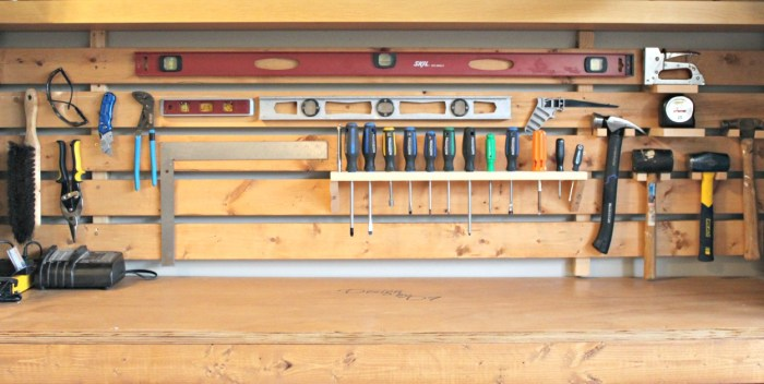 You can make this DIY slat wall for your garage in a day to hold your tools #diyslatwall #slatwall #garageorganization