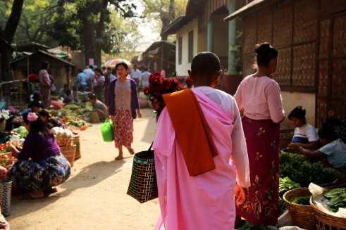 nun walks through market Burma