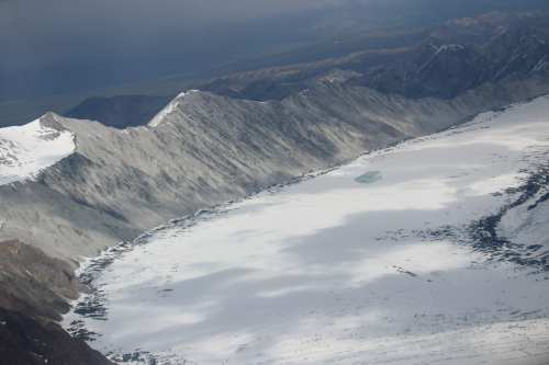 Sweep of the glacier with mountains & moraine