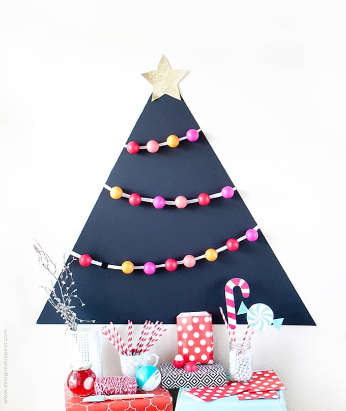 Attach EOS lip balm to a black matteboard for a fun holiday party favor idea! Allow each guest to pick one off the tree to take home!